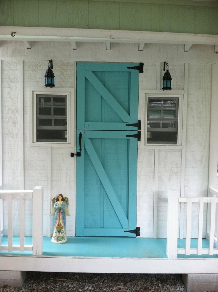 Chicken Coop with a teal door. Um, yes please!