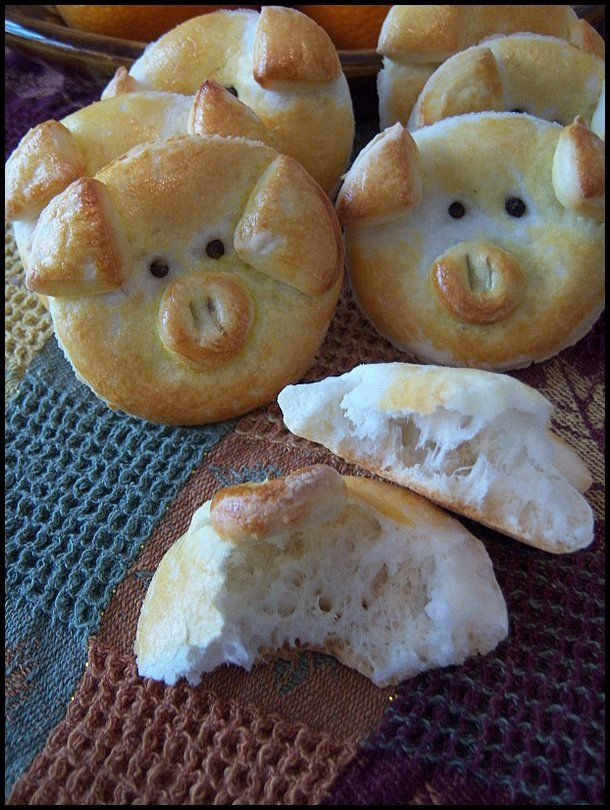 """piggy biscuits use peppercorns for the eyes, some rosemary for each nostril. With all pieces ready, just """"glue it"""" with egg yolk wash. Bake in a preheated oven @ 405 F, for about 15 minutes or so."""