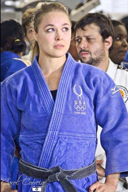 Ronda Jean Rousey -- born February 1, 1987, is an American mixed martial artist, judoka (practitioner of judo) and actress. She is the f irst and current UFC Women's Bantamweight Champion, as well as the last Strikeforce Women's Bantamweight Champion. She is undefeated,  having won nine of her eleven fights by armbar. Rousey became the first American woman to earn an Olympic medal in Judo at the Summer  Olympics in Beijing in 2008.