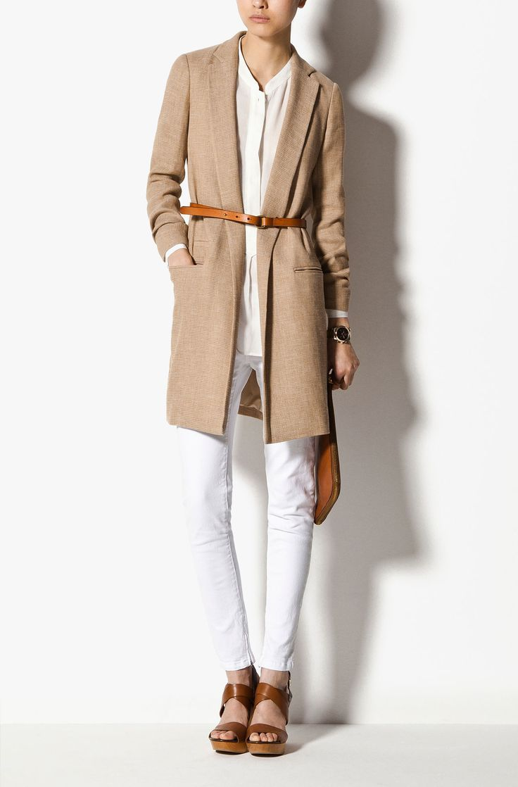 Shop this look on Lookastic:  http://lookastic.com/women/looks/button-down-blouse-coat-belt-watch-clutch-jeans-wedge-sandals/9161  — White Button Down Blouse  — Camel Coat  — Tobacco Leather Belt  — Gold Watch  — Tobacco Leather Clutch  — White Jeans  — Brown Leather Wedge Sandals