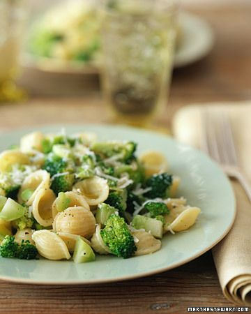 broccoli with orecchiette //     8 ounces orecchiette,  1 tablespoon extra-virgin olive oil,  2 garlic cloves, minced,  1 bunch (about 1 1/2 pounds) broccoli stalks,  1 teaspoon coarse salt,  For the Garnish: 2 tablespoons freshly grated Pecorino Romano cheese