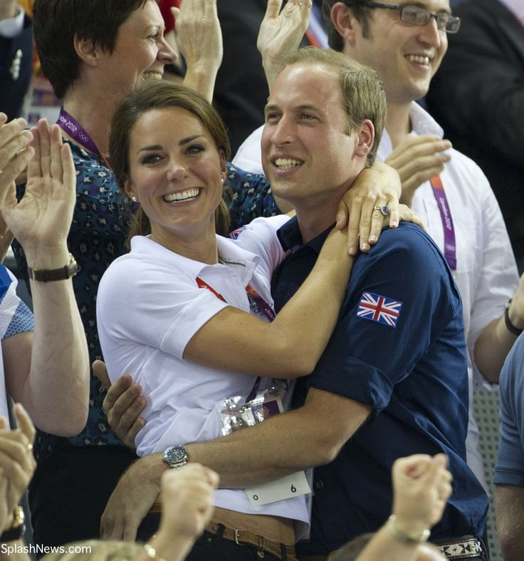 In a rare appearance of PDA, Kate and William embrace as they watch Team GB win a gold medal in track cycling.  They're so cute together!