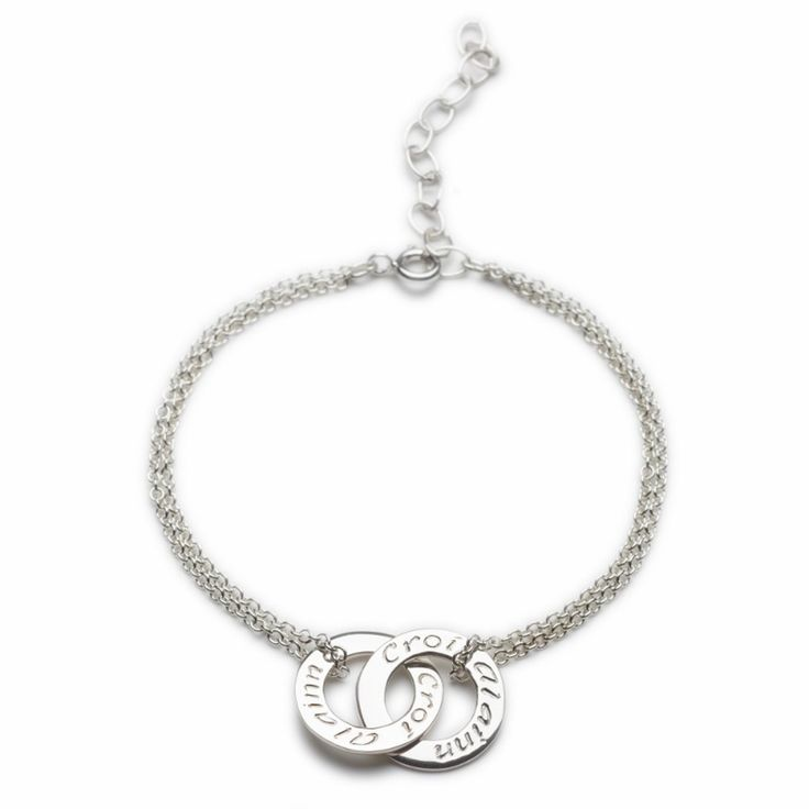 "Another great variation of our best selling silver 'Croí álainn' bracelet with a double mini silver circ. The double chain adds real balance. This bracelet has an extension chain at the back to fit most wrists.'Croí álainn' means 'A beautiful heart' in Irish! Sterling Silver. Diameter: 30mm. Chain: 160-190mm / 6.5-7.5"" length   Available Here: http://www.standun.com/enibas-croi-alainn-double-bracelet.html"