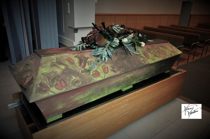 Painted coffin with flowers