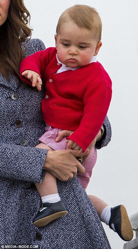 The little prince was smartly dressed in red for the outing... http://dailym.ai/1f9f8pQ#i-5b3f0d25