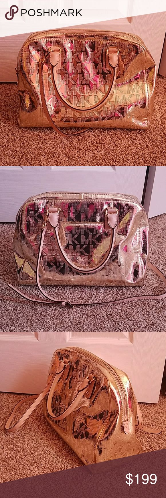 LARGE Michael Kors Metallic Gold tote Hard to find style and size! Gorgeous gold satchel in perfect condition! Handles have nearly no signs of wear. Bag looks rose gold in pictures, but it is the original gold color.  Has one large zip pocket and four smaller pockets. Also has a pocket on the back of the bag to fit cell phone and etc. Comes with removable, adjustable shoulder strap.  *Would consider trading! Michael Kors Collection Bags Totes