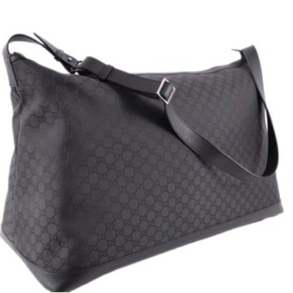 Gucci XL duffle bag Black Gucci nylon duffle bag perfect as a carry on luggage, over night bag or travel bag.  Chic black nylon makes a subtle statement and the nylon material allows for easy cleaning.  Comes with black dust bag.  DIMENSIONS: 28in x 11in x 15 in Gucci Bags Travel Bags