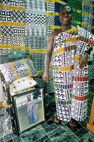 Africa | A Tribal Chief shows his collection of adinkra cloth. Timababe, Ashanti region, Ghana | ©Max Milligan (Photographer) / John Warburton Lee