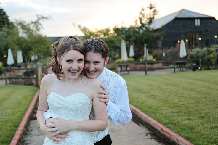 smiling bride and groom photograph.