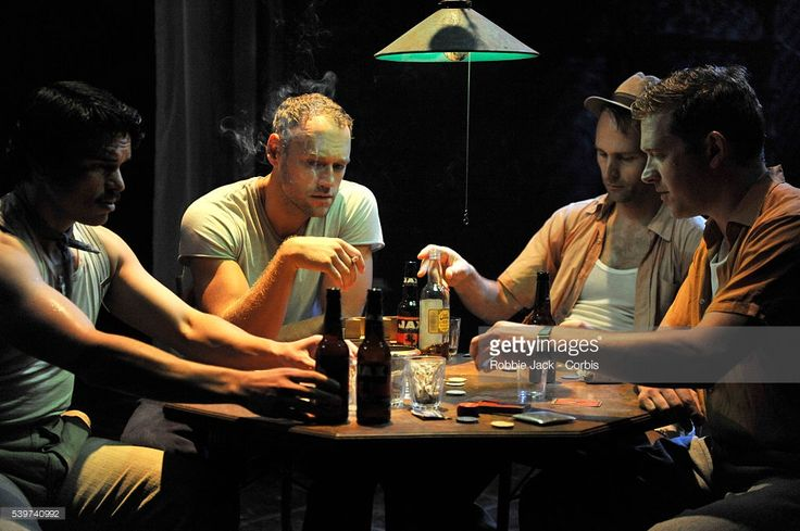 Elliot Cowan as Stanley Kowalski, Barnaby Kay as Mitch, Gary Milner as Steve Hubbel and Luke Rutherford as Pablo in the production of Tennessee Williams's play 'A Streetcar Named Desire',directed by Rob Ashford at the Donmar Warehouse in London.