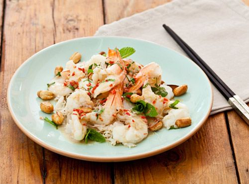 Featuring peanuts and fresh mint, this prawn salad becomes more substantial if combined with softened wide rice noodles or vermicelli.