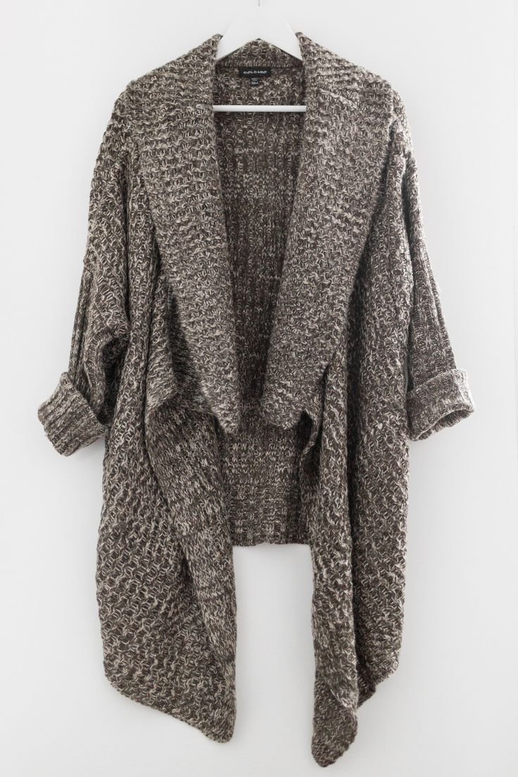 "- Two toned (dark olive & cream) knitted cardigan - Open waterfall front - Loose fit with fitted long sleeves - Asymmetrical silhouette - Size S/M measures approx. 30"" in length (in back) - 55% Cotton"