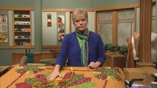 """Nancy demonstrates how to make Dresden Plate quilt designs small, to a super-sized 40"""". Or, totally update the look of the quilt by changing the design using Nancy's new """"Twirling Parasols"""" techniques. You'll be delighted with this fanciful quilting rendition."""