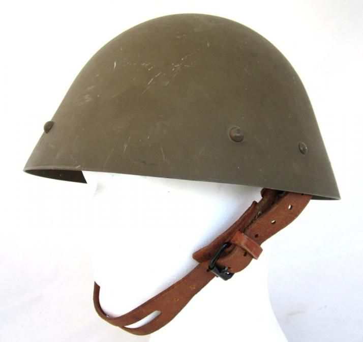 Czech M/34 helmet. 1930´s green-brown paint.  Shell inside marked Sch-M (C.A. Scholtz, Matejovce) 38. Finland bought 50 000 pieces of  this helmet type in 1940.