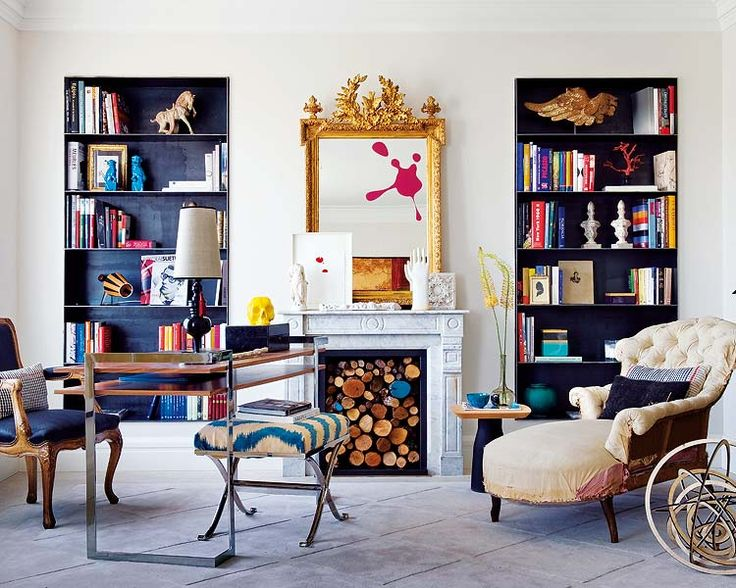 Love the pops of color, even the black bookcases bring in a pop of color. White rooms don't have to be boring!
