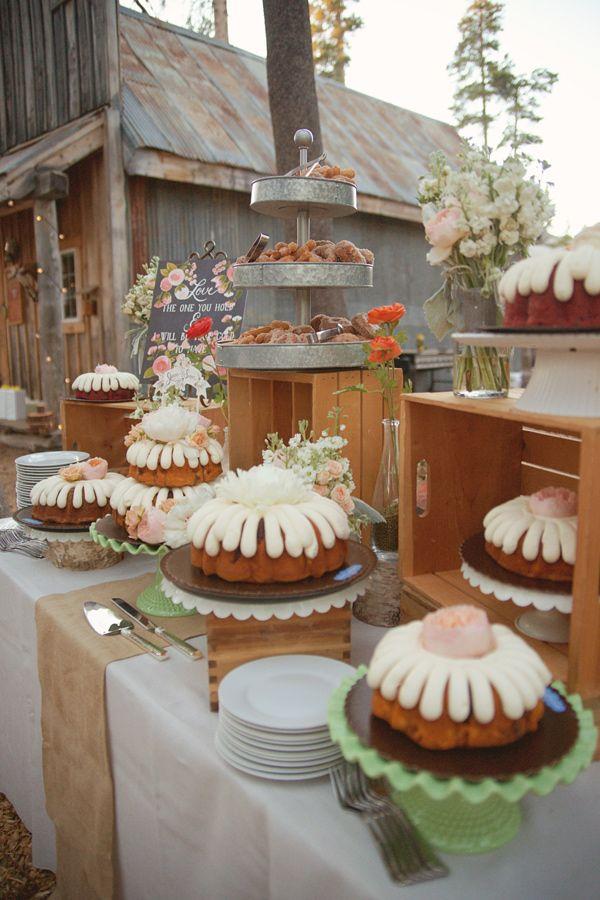bundt cake table, photo by Emily Heizer http://ruffledblog.com/woodsy-sierra-nevada-wedding #desserts #wedding #cakes