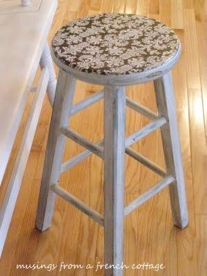 Barstool Makeover - Wrapping paper pattern decoupaged on seat of stool.  Then distressed to let other layers of color show through.  Finished by adding a black laquer and wiping it off using a water soaked cloth.