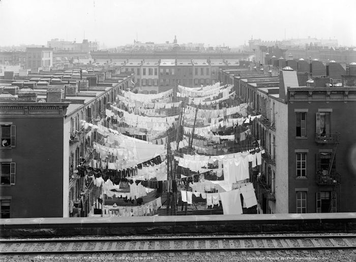 Wear more, wash less.  Earth Day : What we can do to help make a difference.  Photo: New York City, Park Avenue tenement circa 1900