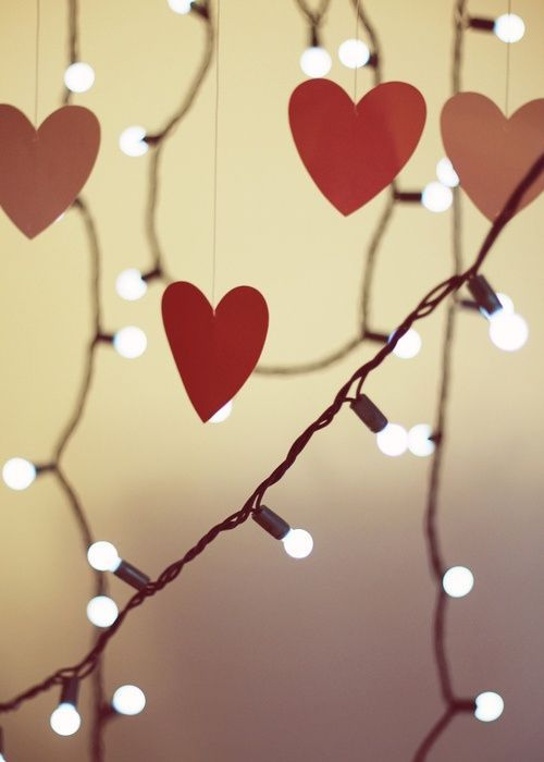 Dangling lights & felt hearts attached to fishing line are perfect for a valentines dinner at home