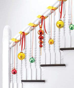 Colorful Banister Display | Looking for new ways to deck the halls? Check these inspired holiday decorations.