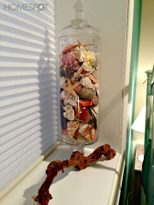 glass container of seashells for home decor