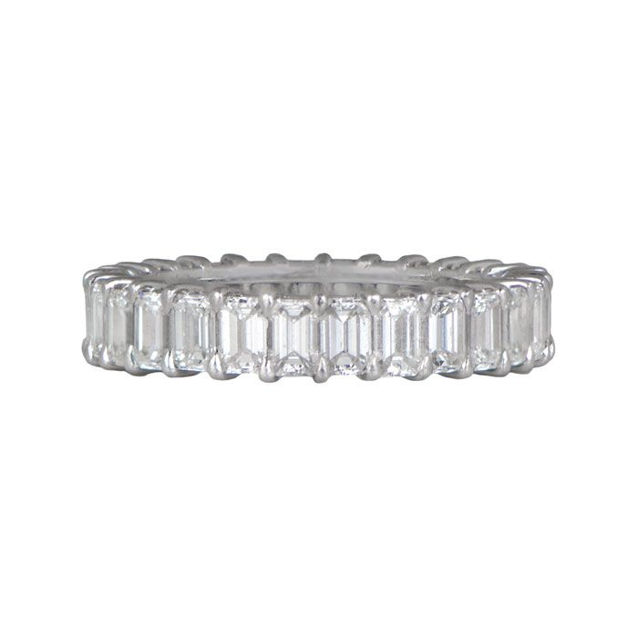 Express your unique love with a truly unique wedding band. Discover the stunning beauty of this emerald cut diamond wedding band at Estate Diamond Jewelry.