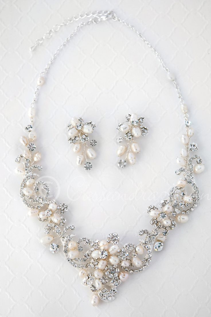 Wedding Necklace of Rhinestone Swirls and Ivory Pearls from Cassandra Lynne