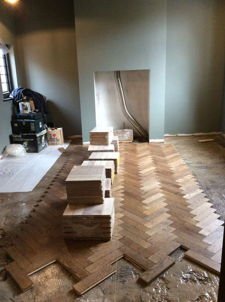 Work in progress.  Ftter Neil Christopher laying Oak Aged Ebony Parquet by The Natural Wood Floor Company.