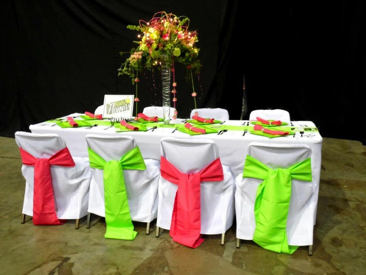 Pink & Green!!!   This centerpiece has green hydrangeas, pink & green roses, pink snaps, green bells of Ireland, accented with greens and hot pink pearls & LED mini lights