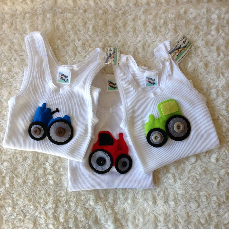 A request for a 'tractor singlet' led to these three singlets being stitched up last night. Hope the little boy is happy to choose one...!  https://www.facebook.com/pages/Little-Mackie/542332459136827