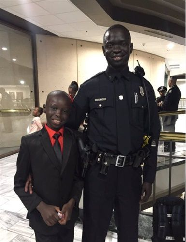 Joseph Mach came to Georgia as a war orphan from Sudan. He is now an American citizen and an Atlanta police officer. (Photo: Atlanta PD via Twitter)