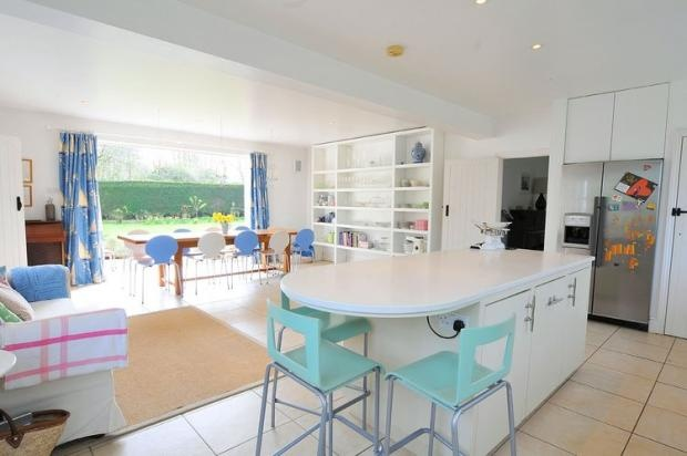 Kitchen diner.  Modern white kitchen.  Pastel colours.  The colours remind me of Cath Kidston's palette.  Mismatched chairs.