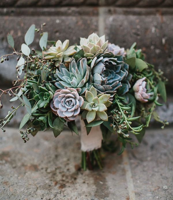 Few things are as impactful to a wedding bouquet as adding succulents. This bridal bouquet skipped the flowers entirely and made a statement with minty monochromatic succulents and eucalyptus leaves.