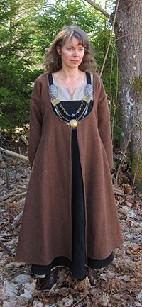 Interesting coat from a Swedish commercial site.  Note the scooped neckline to make sure your Viking bling shows!