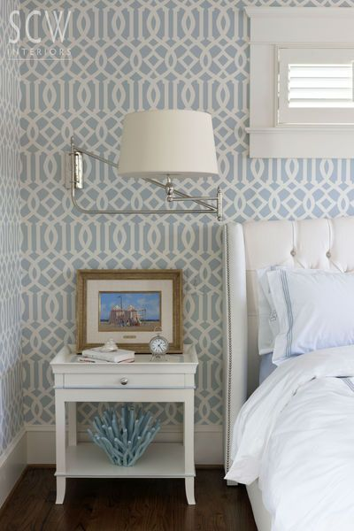 SCW Interiors by Shazalynn Cavin-Winfrey coastal chic bedroom, soft blue and white, wallpaper, window wall behind the bed, wall sconces, adjustable height and width sconces