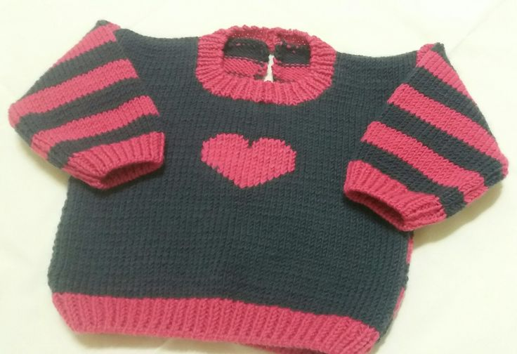 Blue and pink sweater with a  heart