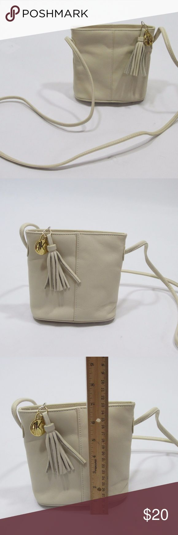 "VTG Anne Klein Cream Pleather Mini Bucket Bag *N23 Excellent vintage condition, a few spots on side and handle (pics 4 &5). Faux leather, simple elegant evening bag from a vintage Anne Klein collection, complete with gold hang tag and fringe tassel. [Size ""Extra small"" 6"" x 5"" x  2.5""] Cream/ off-white.   // No holds, trades, or modeling. Colors may vary on screen. Please use measurements. Offers welcome.   *Last characters in title is inventory number. Anne Klein Bags Mini Bags"