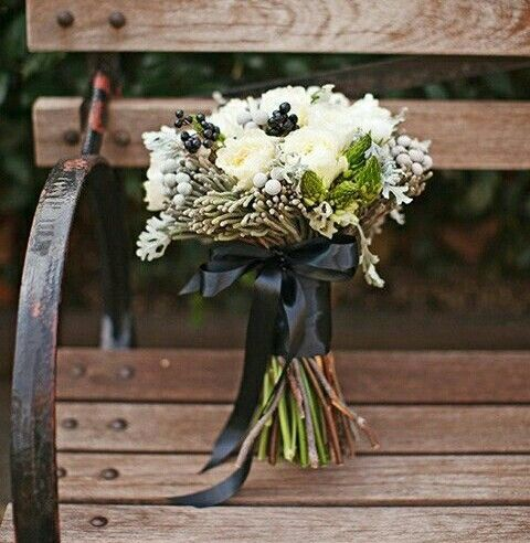 Winter Wedding Bouquet Showcasing: Silver Brunia, Star Of Bethlehem Buds, White Florals, Dark Berries Hand Tied With A Black Ribbon