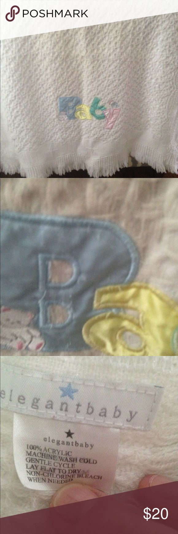 Lovely soft 2' x 3' baby blanket White with pastel letters Excellent condition. Never used. Just hung over Back of loveseat Accessories