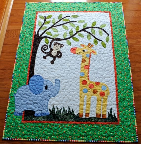 Adorable appliqued baby quilt from Plum Tree Quilts, available from p.s. Goin' Sewin'.com