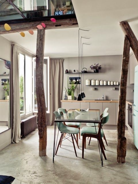 grey kitchen and dining room with mint