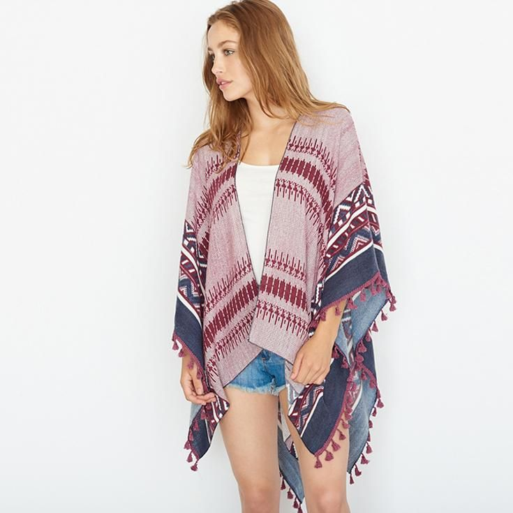 Poncho With Tassels.