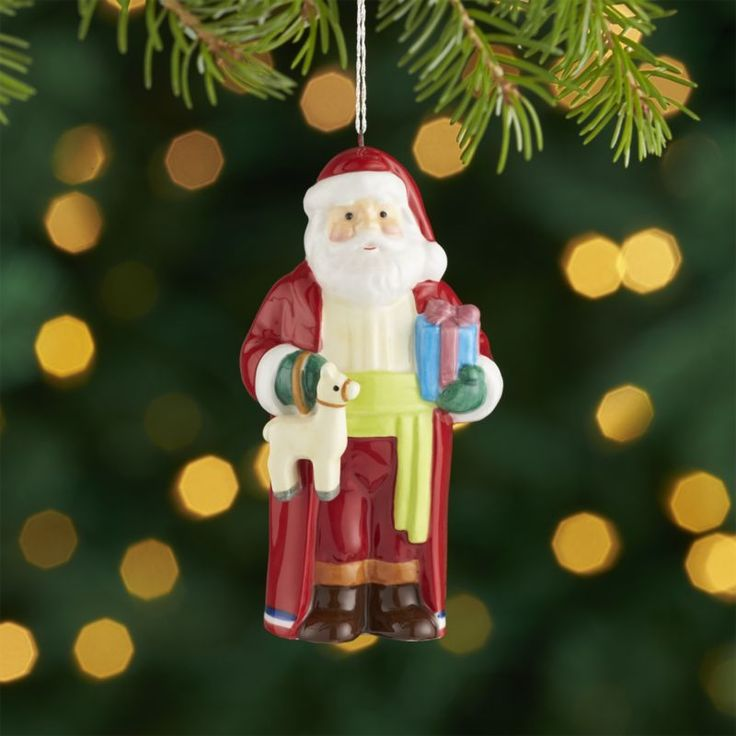 "Shop Around the World Chile Santa Ornament.  Dressed in the traditional toga and belt, this Chilean Santa ornament is inspired by the traditional ""viejito pascuero"" or Old Man Christmas."
