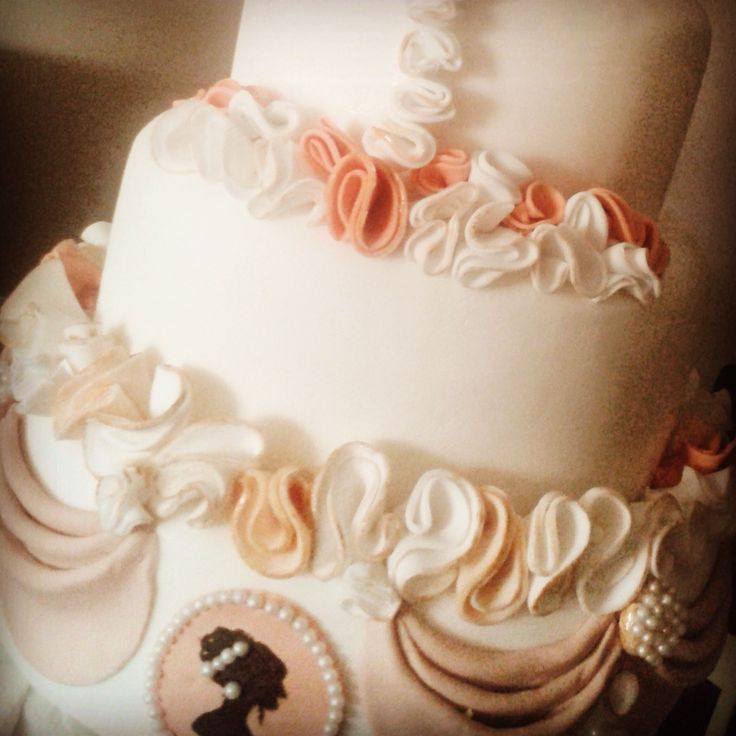 4 tier classic #vintage wedding cake! Entirely handmade with a handpainted cameo & hand formed ruffles!