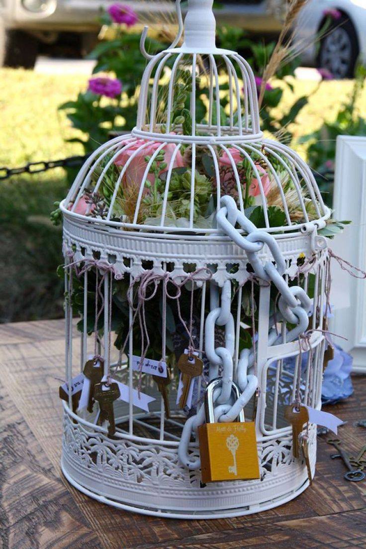 Holly and Matt came up with an amazing alternative to tossing the wedding bouquet: they tied in a love lock theme! They grabbed a bunch of keys, a birdcage, a big ol' lock, and the rest was h…