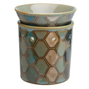 Hand-painted tiles dance across this warmer in a mosaic print inspired by ancient Middle Eastern architecture, weaving a pattern of sea and shell. To purchase, go to www.jenni.scensy.com.au