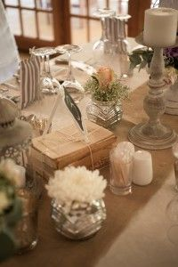 Vintage guest table flowers and decor - Hertford  Country Hotel, Johannesburg. Floral Design by www.pinkenergyfloraldesign.co.za