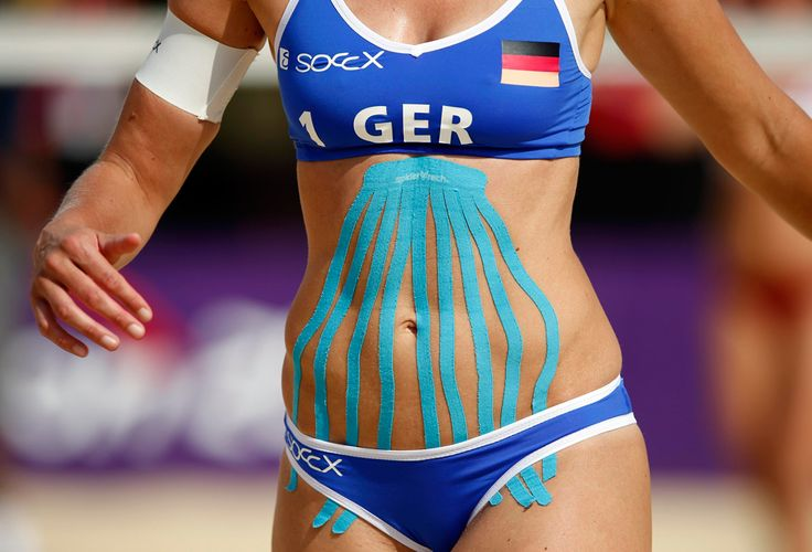 Kinesio tape is seen on Germany's Katrin Holtwick during their women's beach volleyball preliminary match against Czech Republic's Hana Klapalova and Lenka Hajeckova at the Horse Guards Parade, July 28, 2012. Athletic tape made in every colour under the sun seems to be the latest must-have sports injury treatment at London 2012, where athletes may have been influenced by other big name tape fans such as Serena Williams and David Beckham. (Marcelo Del Pozo/Reuters) #