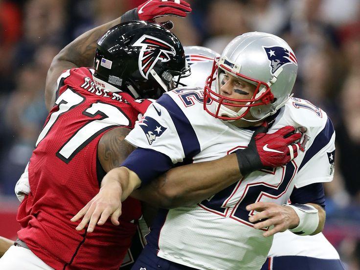 Patriots quarterback Tom Brady (12) just gets rid of