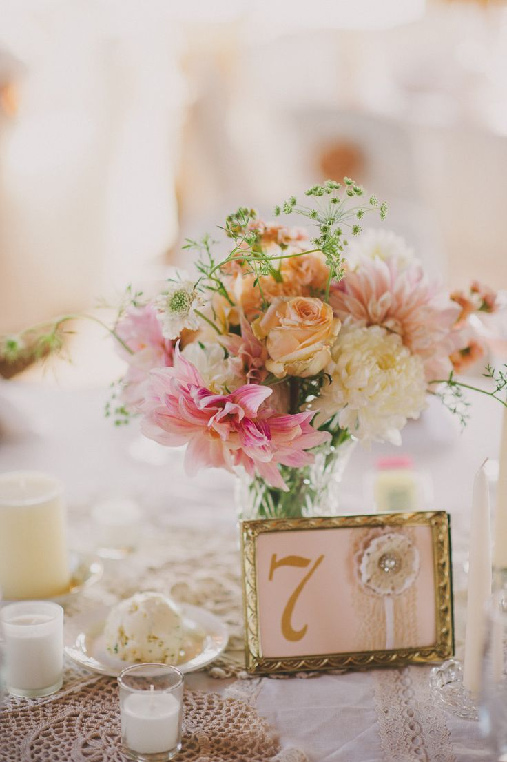 Gilded table with peaches and pinks